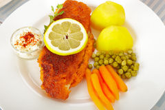 Fish and potatoes Stock Image