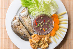 Plate of Fried Mackerel with shrimp paste chili sauce and omelet Royalty Free Stock Image