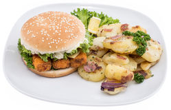 Plate with fried Potatoes and a Fish Burger Stock Photos