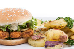 Plate with fried Potatoes and a Fish Burger Royalty Free Stock Photos