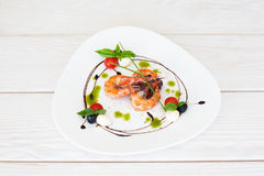 Plate of fried prawns on white wooden background Royalty Free Stock Image