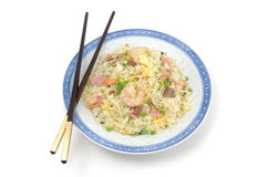 Plate of fried rice and chopsticks Stock Images