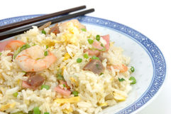 Plate of fried rice and chopsticks Royalty Free Stock Photos