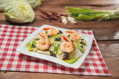 Plate of fried shrimp with vegetables on the table in restaurant royalty free stock image