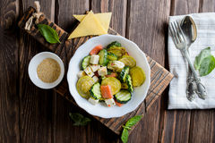 Plate with the fried vegetable marrows salmon salad. On rustic table Royalty Free Stock Photography