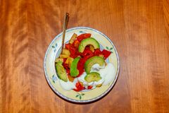 Plate with fried vegetables and row avocado Royalty Free Stock Images