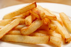 Plate of fries from the side. A plate of crisp fries viewed from the side Stock Image