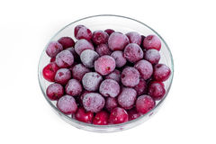 Plate frozen red sweet ripe cherries on a white background. Harvesting of berries for the winter. Stock Photo