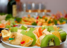 Plate with fruit on a celebratory table. Selective focus Stock Image