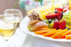 Plate with fruit and glass of champagne Royalty Free Stock Image