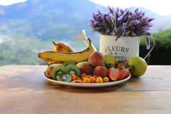 Plate of Fruit and Lavender flowers Royalty Free Stock Image