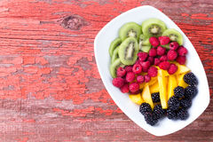 Plate of fruit on old table Stock Photo