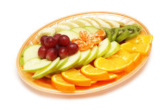 Plate with fruit salad. Isolated on white - space for your text Stock Photos