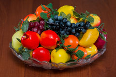 Plate with fruit. On a table Stock Photography