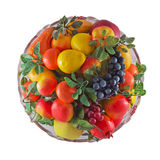 Plate with fruit. On a white background Stock Photo