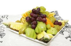 Plate with fruits and berries Stock Images