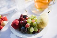 Plate with fruits and berries for dessert on the table royalty free stock image