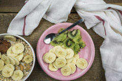 Plate with fruits and bowl of muesli Royalty Free Stock Photo