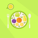 Plate with fruits and glass of juice on a table. Vegetarian food concept Stock Photos