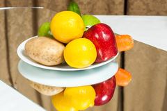 Plate of fruits and vegetables Royalty Free Stock Image