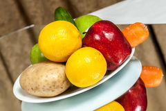 Plate of fruits and vegetables Stock Photos