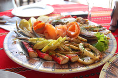 Plate of frutti di mare. Served on traditional Bulgarian table Royalty Free Stock Images