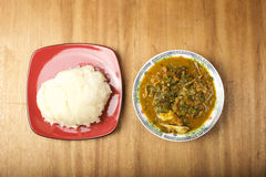 A plate of fufu and Oha Soup. A Nigerian staple meal which is made up of ground cassava which is eaten with Oha soup Royalty Free Stock Photography