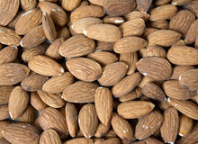 A plate full of almonds Royalty Free Stock Photo