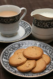 Plate full of biscuits served with tea Royalty Free Stock Image