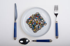 Plate full of colorful sharp thumbtacks Stock Photos