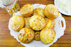 Plate full of corn bread muffins on a table Stock Photos