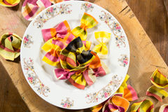 Plate full of delicious colorful ravioli pasta on a wooden  surface Stock Image