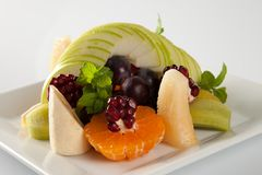 Plate full of fresh fruits Stock Photos
