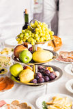 Plate full of fresh fruits on a festive table Stock Photography