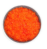 A plate full of fresh red caviar. On white background Royalty Free Stock Photo
