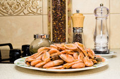 The plate full of prawns. Against the background of pepper shaker and salt shaker Stock Image