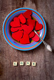 Plate full of red hearts with text Love Royalty Free Stock Photos