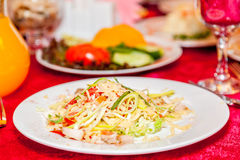 A plate is full of salad in a restaurant Stock Image