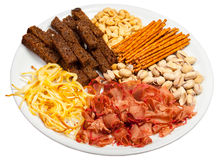 Plate full of salted snacks Royalty Free Stock Images