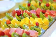 Plate full of sliced fresh fruits Stock Images
