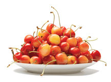 Plate full of a sweet cherry. Plate full of a ripe red sweet cherry on a white background Stock Images