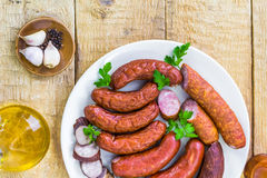 Plate full various species sausages Stock Photos