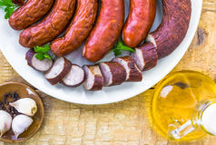 Plate full various species sausages Royalty Free Stock Image