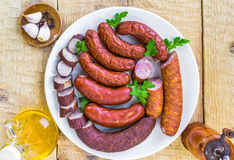 Plate full various species sausages Stock Image