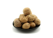 A plate full of walnuts Stock Image