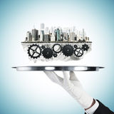 Plate with gears and city Royalty Free Stock Photography