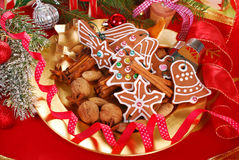 Plate with gingerbread cookies and spices for christmas Stock Photos