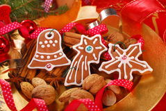 Plate with gingerbread cookies and spices for christmas Royalty Free Stock Photo