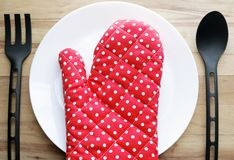 Plate and gloves Royalty Free Stock Photos