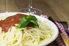 Plate of gluten free spaghetti with tomato sauce and basil Stock Images